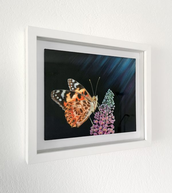 Painted lady butterfly painting in a white picture frame
