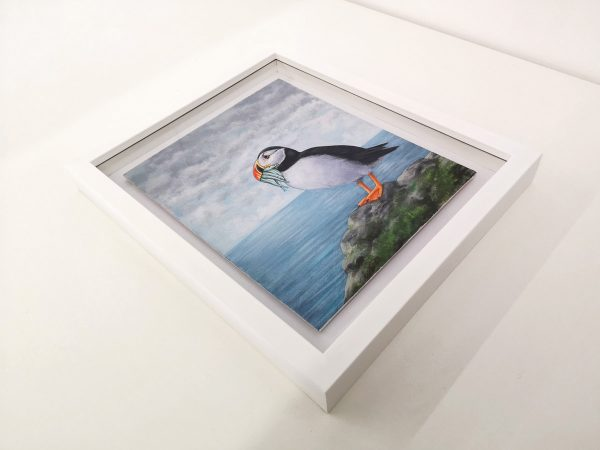 Puffin painting in a white picture frame