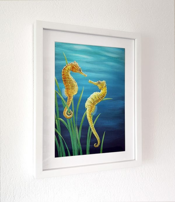 Seahorse painting in a white picture frame