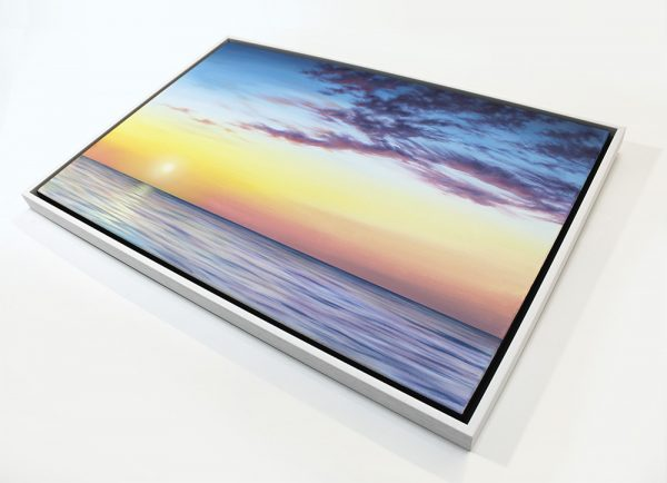 Sunset and sea painting in the picture frame