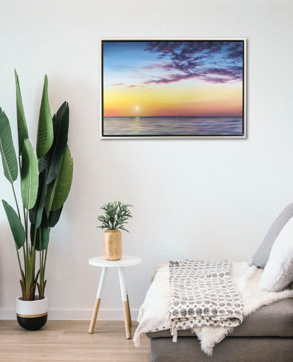 Framed pictured of an ocean sunset on the wall