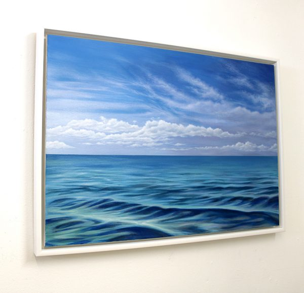 Framed seascape painting on the wall