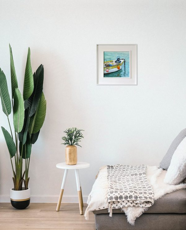Painting of a Cornish fishing boat hanging on the wall